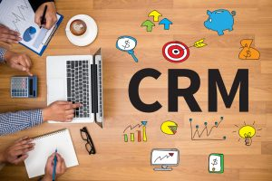 CRM Business Customer CRM Management Analysis Service Concept Business team hands at work with financial reports and a laptop